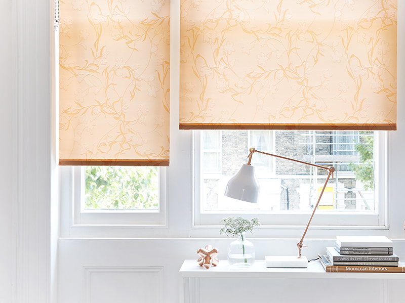 Peach roller blinds in a small contemporary home office