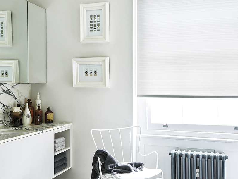 White roller blind in a white modern bathroom