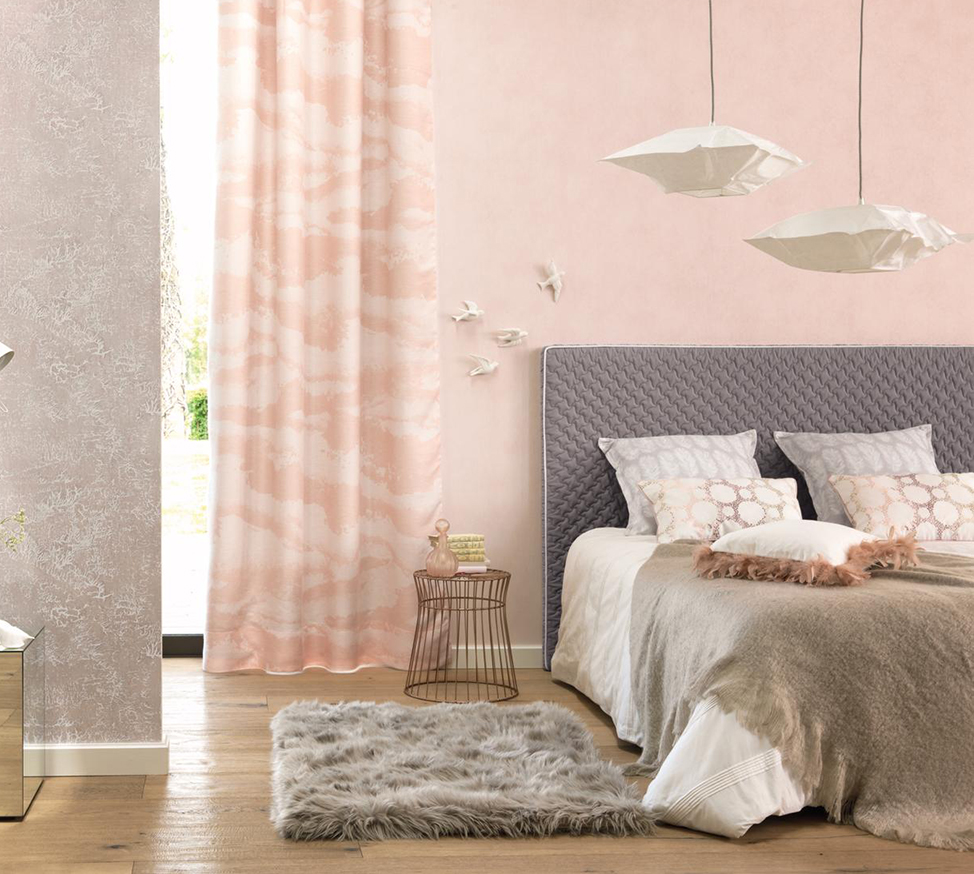 Soft pink bedroom with white accessories.