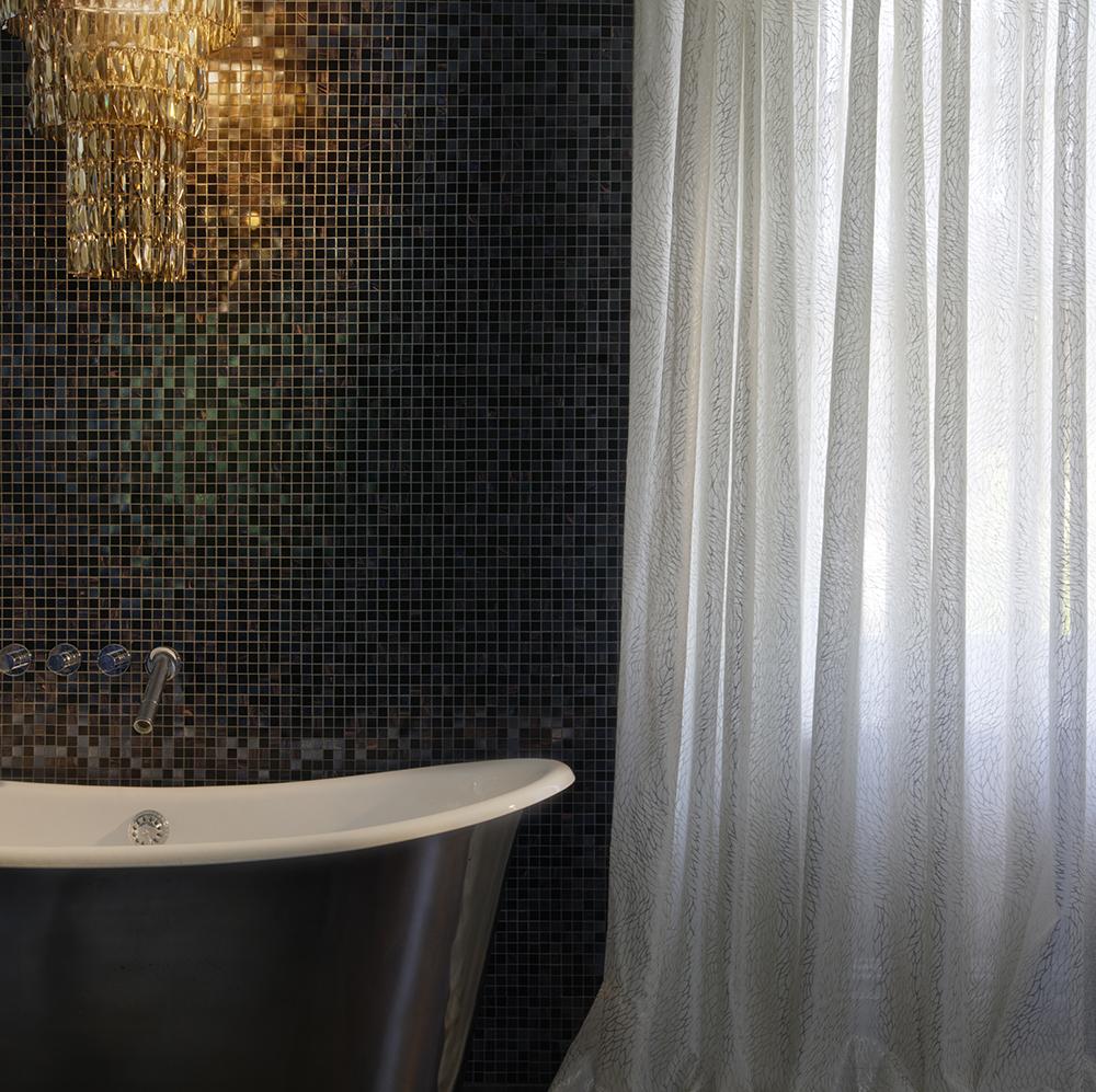 Glamorous black bathroom with white voile.