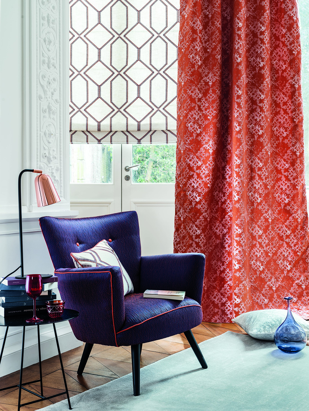 Orange red curtains in mid-century modern room.