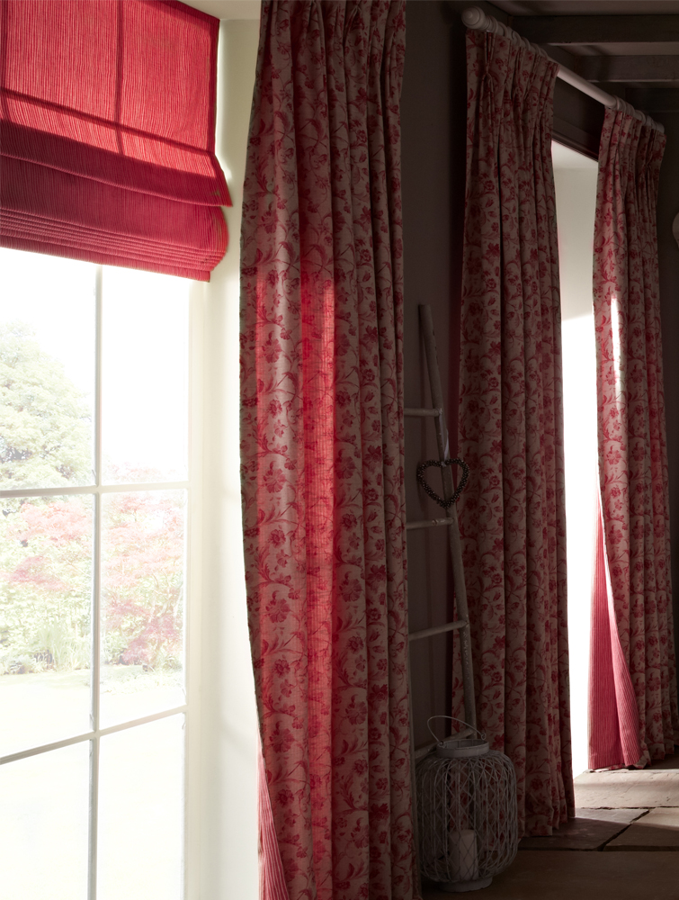 Dark red curtains and red Roman blinds.