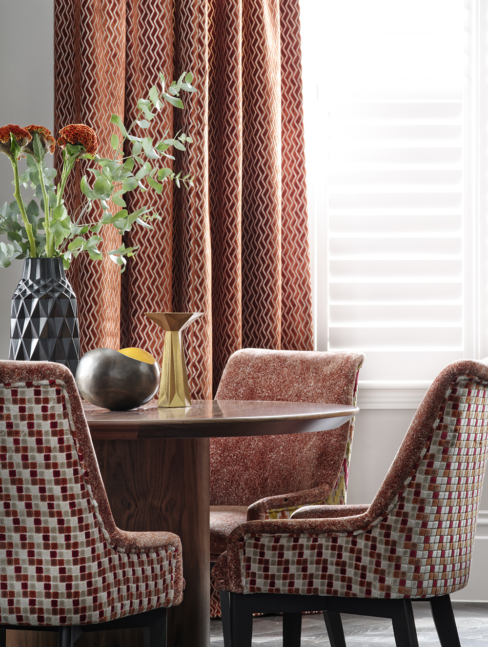 Warm terracotta decor in dining room.