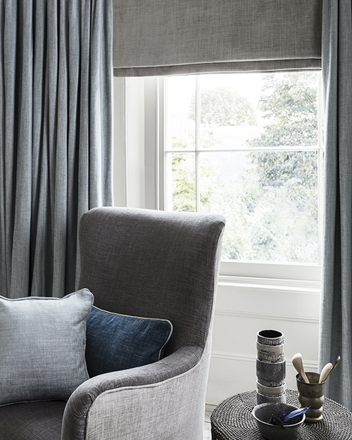 Grey and blue decor in reading corner