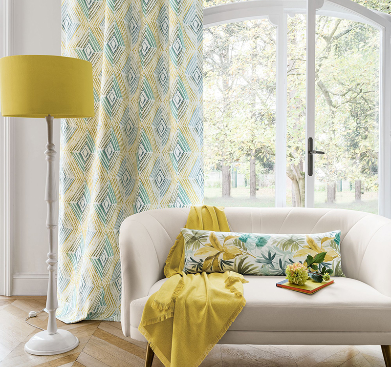 Colourful living room with bright yellow floor lamp