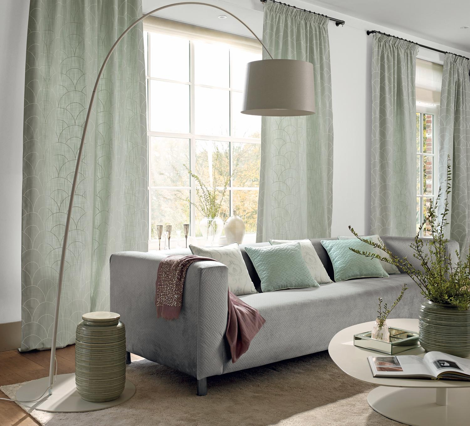 Curving floor lamp with grey lamp shade