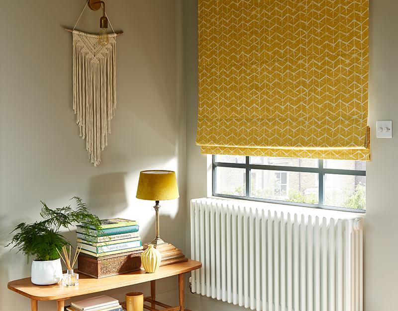 Mid-century modern interiors with mustard yellow Roman blind