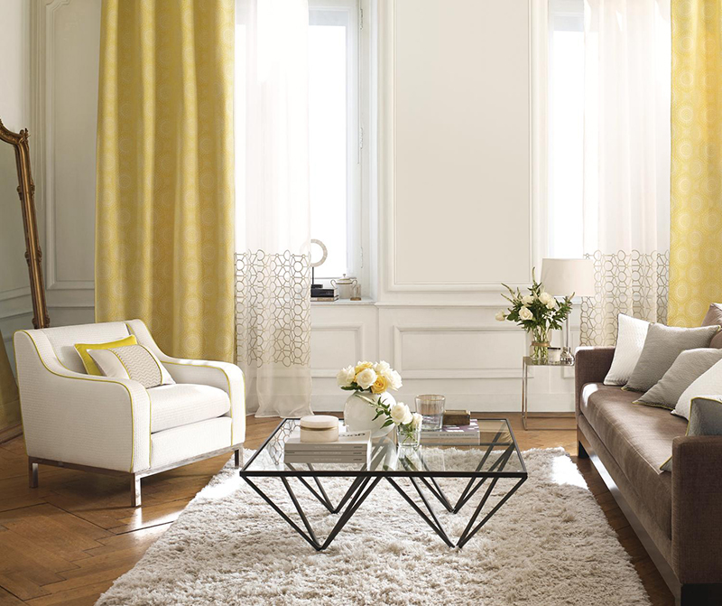 Neutral modern interiors with lemon yellow curtains