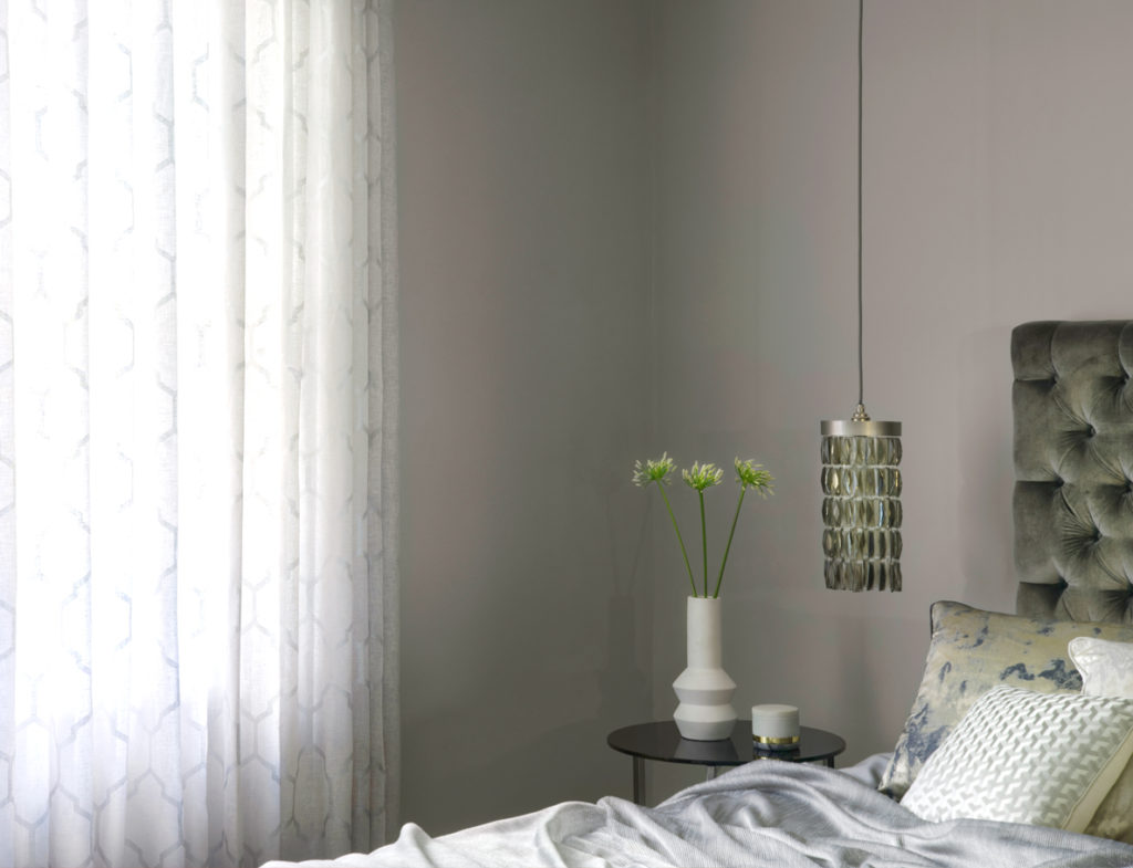 Voile wave curtains in a bedroom.
