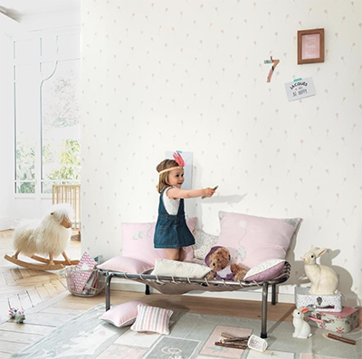 Child playing in a safe bedroom