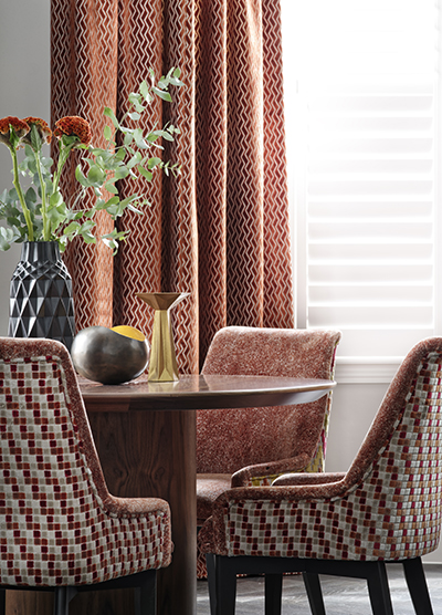 Dark red curtains for a traditional dining room.