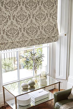 Elegant Roman blind for a traditionally designed living room.