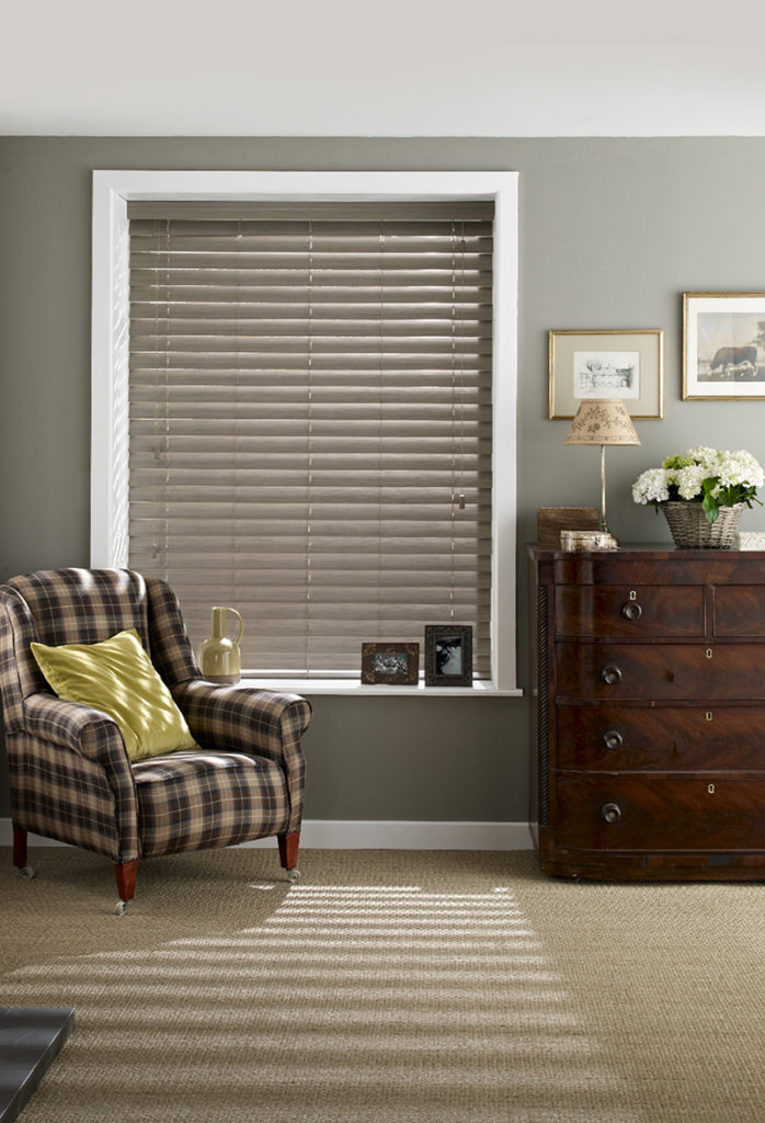 A light wooden blind for a traditional bedroom.